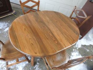 vintage mid century modern oak table matching and 4 chairs