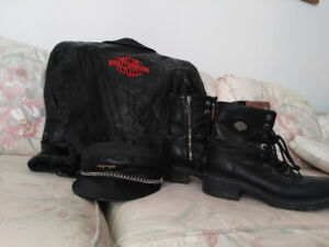 Harley Davidson hat, boots. Leather jacket with H.D. emblem.
