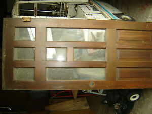 Two used solid wood doors with windows 32x 79.5 doors only