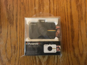 """Polaroid """"Snap touch"""" camera and 50 pack film"""