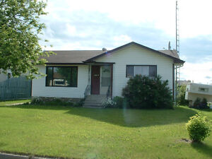 945 Sq.Ft Home WITH 3 bay,heated Garage with attached shop .