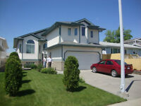 Bi level house with posh three bedroom suite  west end for sale