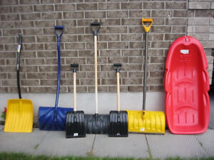 Pristine condition snow sled and snow shovels for sale