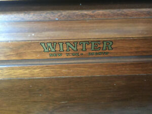 """Winter"" Solid wood piano in great condition. Pick up is Oakvil"