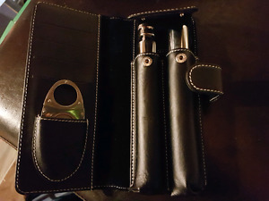 Stainless steel cigar holders and cutter in leather pouch