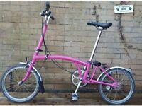 Brompton pink folding bicycle ladies bike
