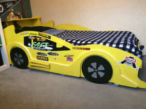 Race car bed, hand crafted, yellow, solid wood frame on wheels