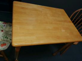Small pine table x 2 chairs