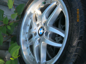 BMW 3 series mags /rims including tires et of 4