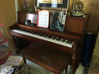 Console Piano with bench  (IN LAKE COUNTRY NOT VERNON)
