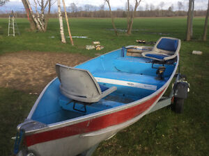 12ft aluminum boat with 6hp and trailer.