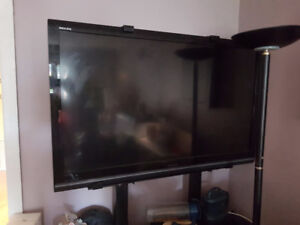 60 in Tv Regza, rack and sound system