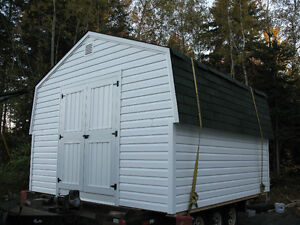 Storage shed with turn table