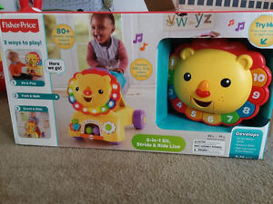 CHEAP & in-box: Fisher-Price sit, stride, ride lion toy FRENCH