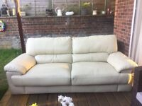 Beige 3 seater sofa.