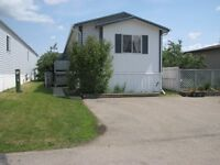 Great 1216sqft Mobile in Parkland Village for only $119,900