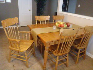 A Harvest Table and Chairs set