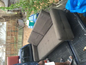 Beautiful new unused sleeping dark grey couch-bought but not use
