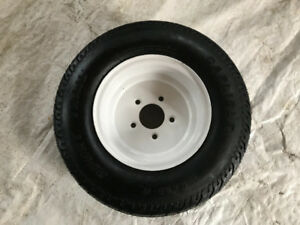 Tire and rim to fit skidoo or utility trailer.