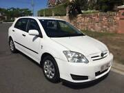 2005 Corolla Hatchback Manual Ascent ZZE122R White 4cyl 5 Door Coorparoo Brisbane South East Preview