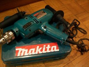 Mackita HIammer drill with cement drill bits
