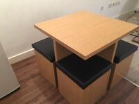 Compact kitchen table with storage chairs