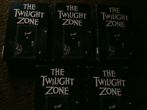 5 VHS tapes of Twilight Zone.  4 half hour episodes per tape.