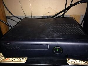 Xbox 360 elite 250 GB with over 70 games and 4 controllers $300