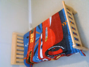 Natural wood sleigh bed for toddlers
