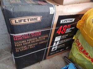 "Brand new Lifetime Portable Basketball net - 48""."