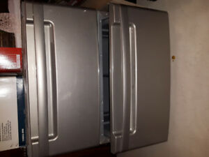 LG washer and dryer base with storage drawer.
