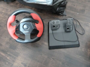 Logitech Video game Racing steering wheel and foot pedals.