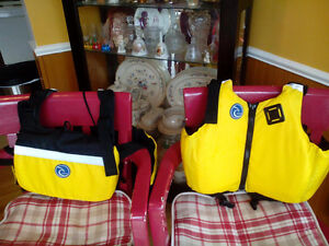 FOR SALE: 2 new adult's life jackets half price!