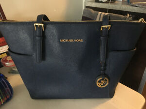 2101a12510a4 Michael Kors Leather Tote Bag
