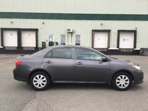 2010 Toyota Corolla CE Sedan - low km, registered, 4 extra tires