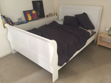 Large wooden queen sized bed with double mattress