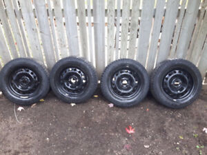Four P195/60R15 winter tires with rims
