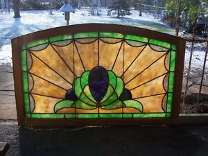 Antique stained glass window, curved top