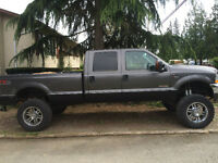 LIFTED F-350 FOR TRADE FOR F150 OR SIMILAR SIZE TRUCK.....LOW KM