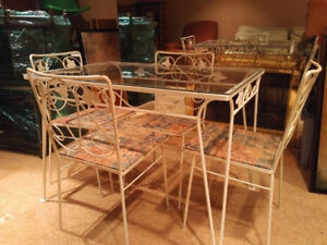 Glass top table with chairs.