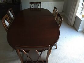 Extendable table and 6 chairs (2 carvers)