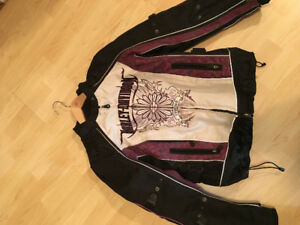 For sale ladie's Harley Davidson bikers jacket and boots.