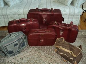 4 piece luggage set , 2 misc. shoulder bags and 1 back pack.