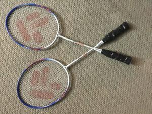 A pair of Techno pro Badminton Racquet