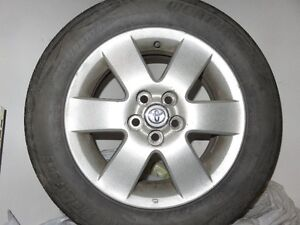 (4) 195 65 15 tires and alloy wheels