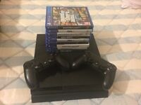 Playstation 4 500 gb + ps plus account 1 year + 2 pads + charging tower + 35 games!!!