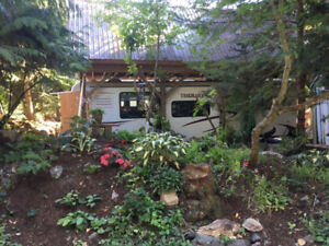 RV Lot with Snow Loft/Sleeping Area above - H13
