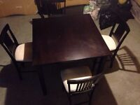 Selling a kitchen table and four chairs best offer