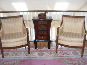 Matching occasional chairs and cabinet set.