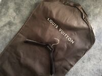 Luxury authentic Louis Vuitton clothes protector (dust bag) and velvet hanger